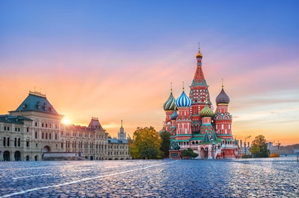 St. Basil's Cathedral and golden first rays of the sun