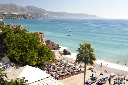 Aerial view of Nerja beach in Spain with mountain view