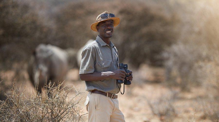 Safari guide with rhino