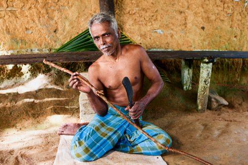 Man preparing cinnamon, Sri Lanka